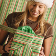 Girl With Christmas Present — Stock Photo #31612299