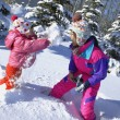 Mother And Daughter Having A Snowball Fight — Stockfoto