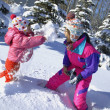 Mother And Daughter Having A Snowball Fight — Foto de Stock