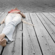 Stock Photo: WomLying On Dock