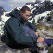 Mountaineer Using Camping Stove — Stock Photo #31613575