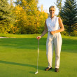 Woman With Putter — Stock Photo