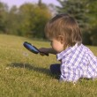 Stock Photo: Young Boy With Magnifying Glass