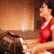 Woman Plays The Piano And Sings — Stock Photo