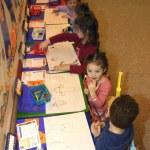 Preschool Age Children Drawing Pictures In Their Kindergarten Class — Stock Photo