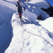 Mountaineer On Snowy Slope — Stock Photo #31615805