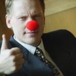 Businessman Wearing Clowning Around — Stock Photo #31615951