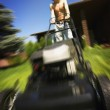 Guy Wearing Silly Glasses Mowing Lawn — Stock Photo