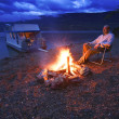 Stock Photo: MOn Shore Relaxing At Campfire