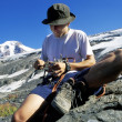 Mountaineer Checking Equipment — Stock Photo #31616473