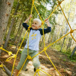 Child Climbing Ropes — Stock Photo #31616785
