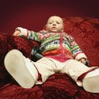 Stock Photo: Child Sits On Sofa