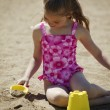 Stock Photo: Child Playing In Sand