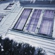 Stock Photo: Icicles On House
