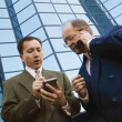 Stock Photo: Businessmen Outside Office Building