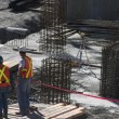 Stock Photo: Building Site And Two Construction Workers