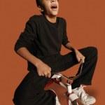Teenage Boy On Tiny Bicycle — Stock Photo #31619857