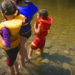 Stock Photo: Three Children Paddling In Lake