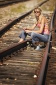Woman Sitting On Train Tracks — Stock Photo