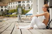 Woman Sits On A Dock — Stock Photo