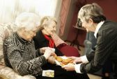 Elderly Women Having Cookies — Stock Photo