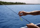 Lure Being Put On Fishing Line — Stock Photo