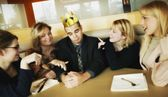 Man With Flimsy Crown On Head And Women Paying Attention To Him — Stock Photo