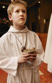 Alter Boy Holding Container — Stock Photo