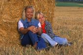 Mom And Daughter Resting In The Hayfield — Stock Photo