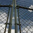 Stock Photo: Chain Link Gate With Barbed Wire