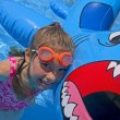 Girl Playing In Swimming Pool With Inflatable Shark — Stock Photo #31620317