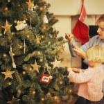 Decorating A Christmas Tree — Stock Photo