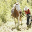 Stock Photo: Cowgirl With Horse And Dog