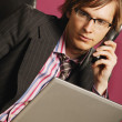 Stock Photo: BusinessmWith Phone And Lap Top
