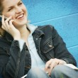 Student With Textbook And Cell Phone — Stock Photo