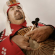 Stock Photo: Native AmericMHolding Ceremonial Drum