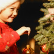 Girl Hanging Ornament On Christmas Tree — Stock Photo