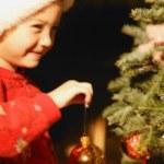 Girl Hanging Ornament On Christmas Tree — Stock Photo