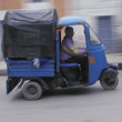 Stock Photo: MDriving Three-Wheeled Van