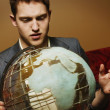 Stock Photo: Businessman Looking At A Globe