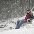 Stock Photo: MSitting On Chair In Snow