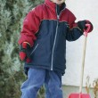 Child With Snow Shovel — Stock Photo