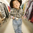 Stock Photo: Child Tries On Clothes