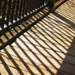 Stock Photo: Shadow Of Wooden Railing