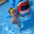 Girl Playing In Swimming Pool With Inflatable Shark — Stock Photo #31624301