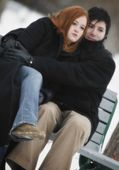 Couple Sitting On Bench In Winter — Stock Photo
