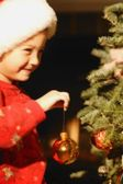 Girl Hanging Ornament On Christmas Tree — ストック写真