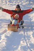 Father And Daughter Tobogganing — Stock Photo