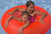Two Girls With Rubber Ring In Pool — 图库照片