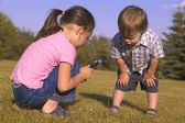 Young Children With Magnifying Glass — Stock Photo